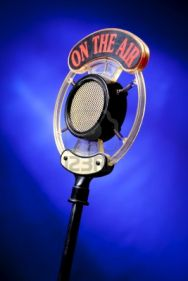 9435701-radio-microphone-on-blue-background